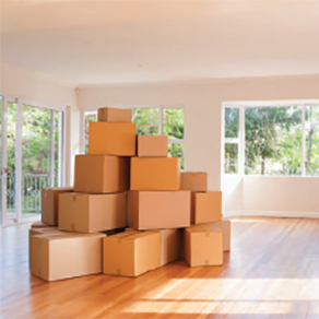 Moving boxes stacked in empty house