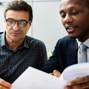 Two men looking at papers on estate planning