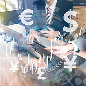 Abstract image of business men on computer with visual representation of foreign currency symbols