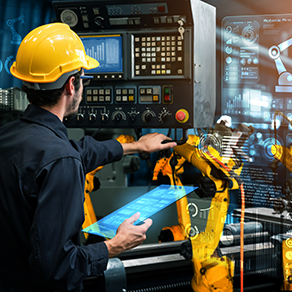 Male employee showing automation manufacturing process with smart industry robot arms for digital factory production technology