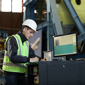 Portrait of a man in a manufacturing factory controlling the work process