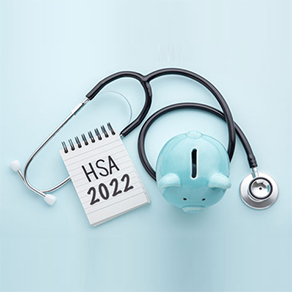 """Doctor's stethoscope wrapped around a notepad with the words """"HSA 2022 on it,"""" and a blue piggy bank"""