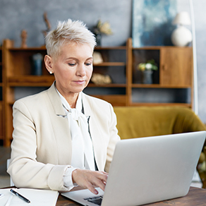 Businesses woman at table with a laptop