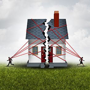 A house being pulled apart by two people and multiple red strings