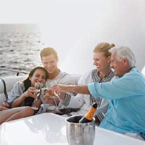 Two couples sitting on a boat toasting