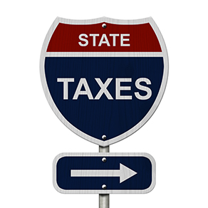 """Road sign that says """"State Taxes"""" with arrow pointing right"""