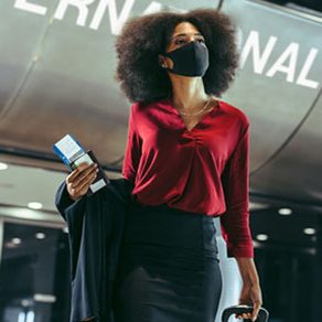 Woman walking through an airport