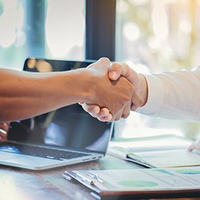 Businessman handshake at business meeting